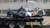 The Porsche 919 Hybrid of Mark Webber is taken away after a major crash with Matteo Cressoni