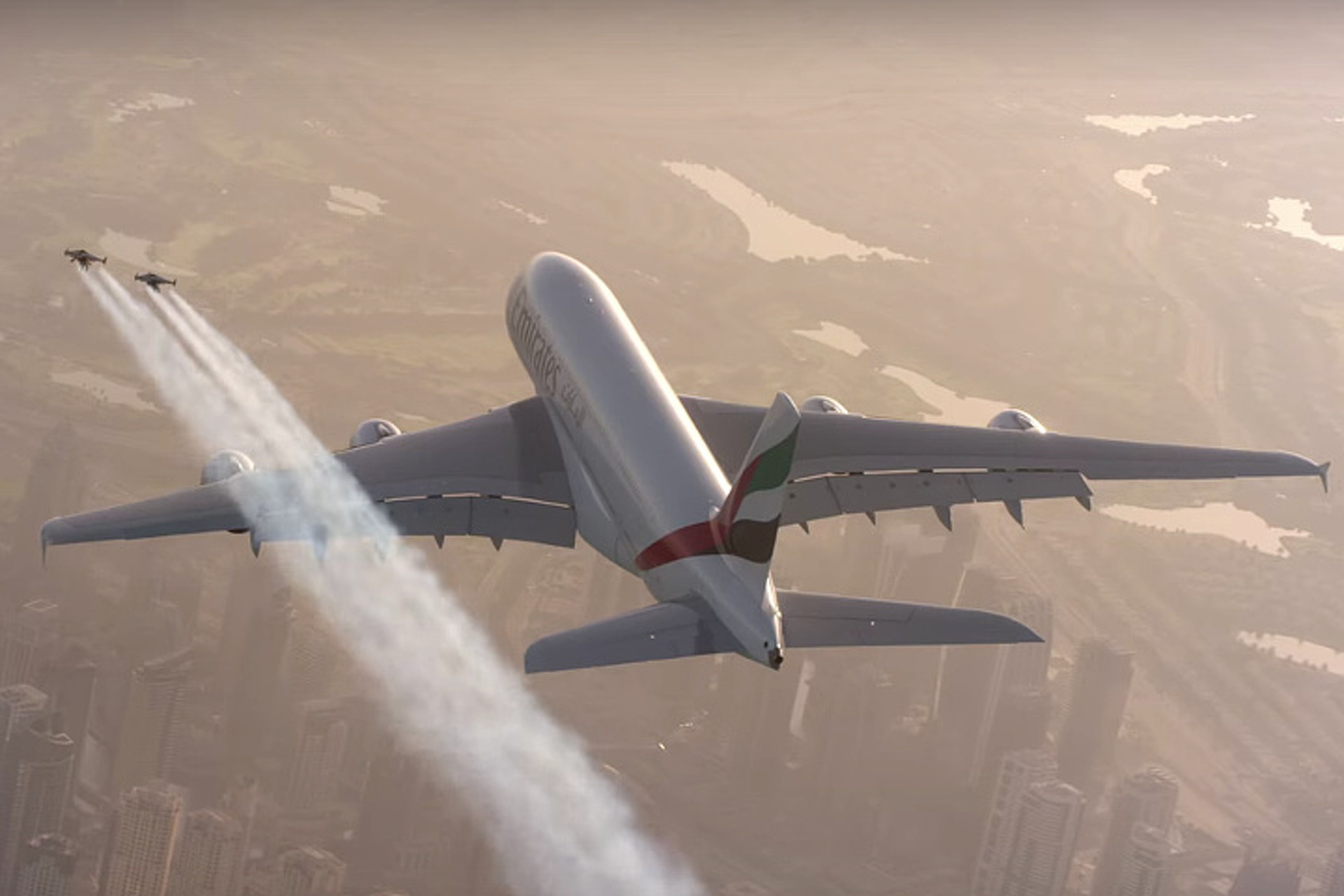 Watch Two Guys in Jet Packs Fly Alongside an Emirates Plane