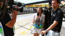 (L to R): Jennie Gow, BBC Radio 5 Live Pitlane Reporter with Jolyon Palmer, Lotus F1 Team Test and Reserve Driver