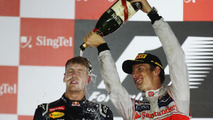 Sebastian Vettel on podium with Jenson Button, Singapore Grand Prix, 23.09.2012