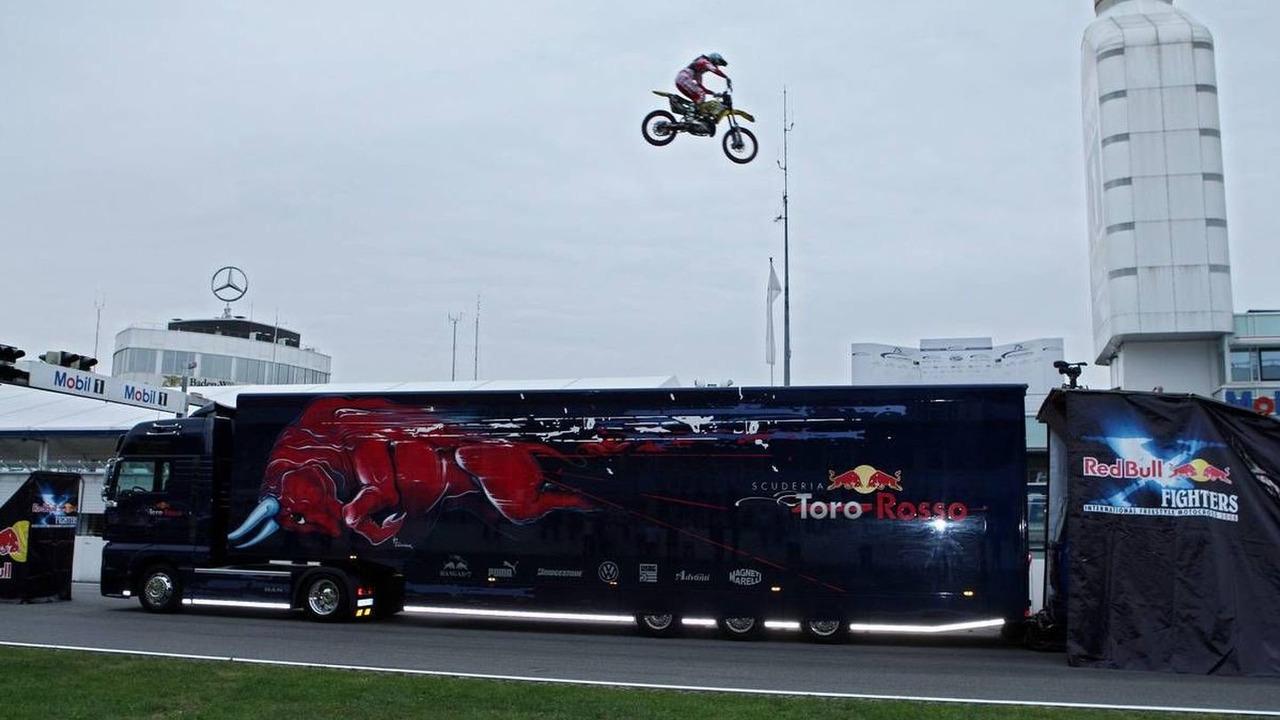 Red Bull X-Fighters Demo Show. Busty Wolter (GER) jumps over Sebastian Vettel (GER), standing on a Toro Rosso Truck - Formula 1 Testing, Hockenheim, 09.07.2008 Hockenheim, Germany