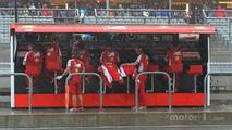 Ferrari pit gantry under heavy rain