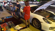 Porsche Cayman owner in China selling scarves to buy fuel