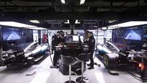 The Mercedes team at work in the garage