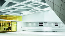"""The Foyer of the new Porsche-Museum with a view into the Museum Restaurant """"Boxenstopp"""" (left)"""