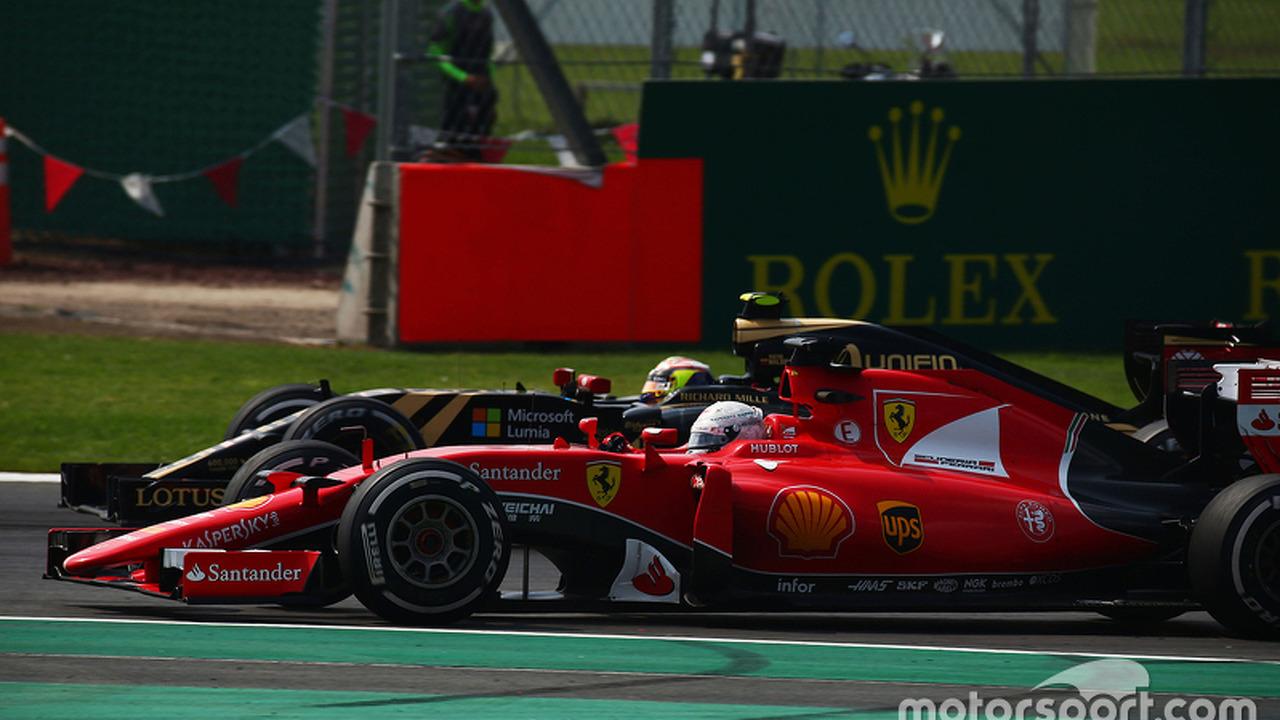 Sebastian Vettel, Ferrari SF15-T and Pastor Maldonado, Lotus F1 E23 battle for position