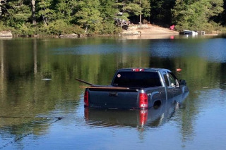 Dog Gets Put in Timeout, Responds by Driving Owner's Truck into Lake